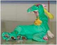 Image of a skater in a dinosaur costume